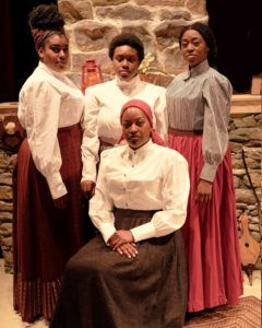 Brenau students Ameena McKenzie (top left), Kennedy Salters and Jaymyria Etienne, and guest actor Annette Grievous (seated) portray frontier women who must care and sacrifice for each other in FLYIN' WEST, which opens with free performances on Nov. 11 at the UNG-Gainesville's Ed Cabell Theatre.