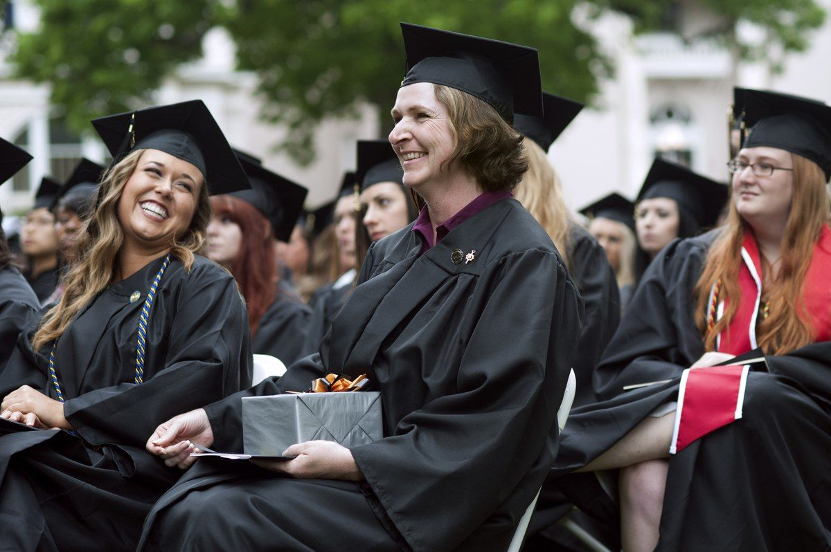 Rane Tipton, left, looks to Melissa Tavilla after Tavilla was awarded the Cora Anderson Hill Award for highest graduating class grade point average at the 2013 Women's College Commencement ceremony.