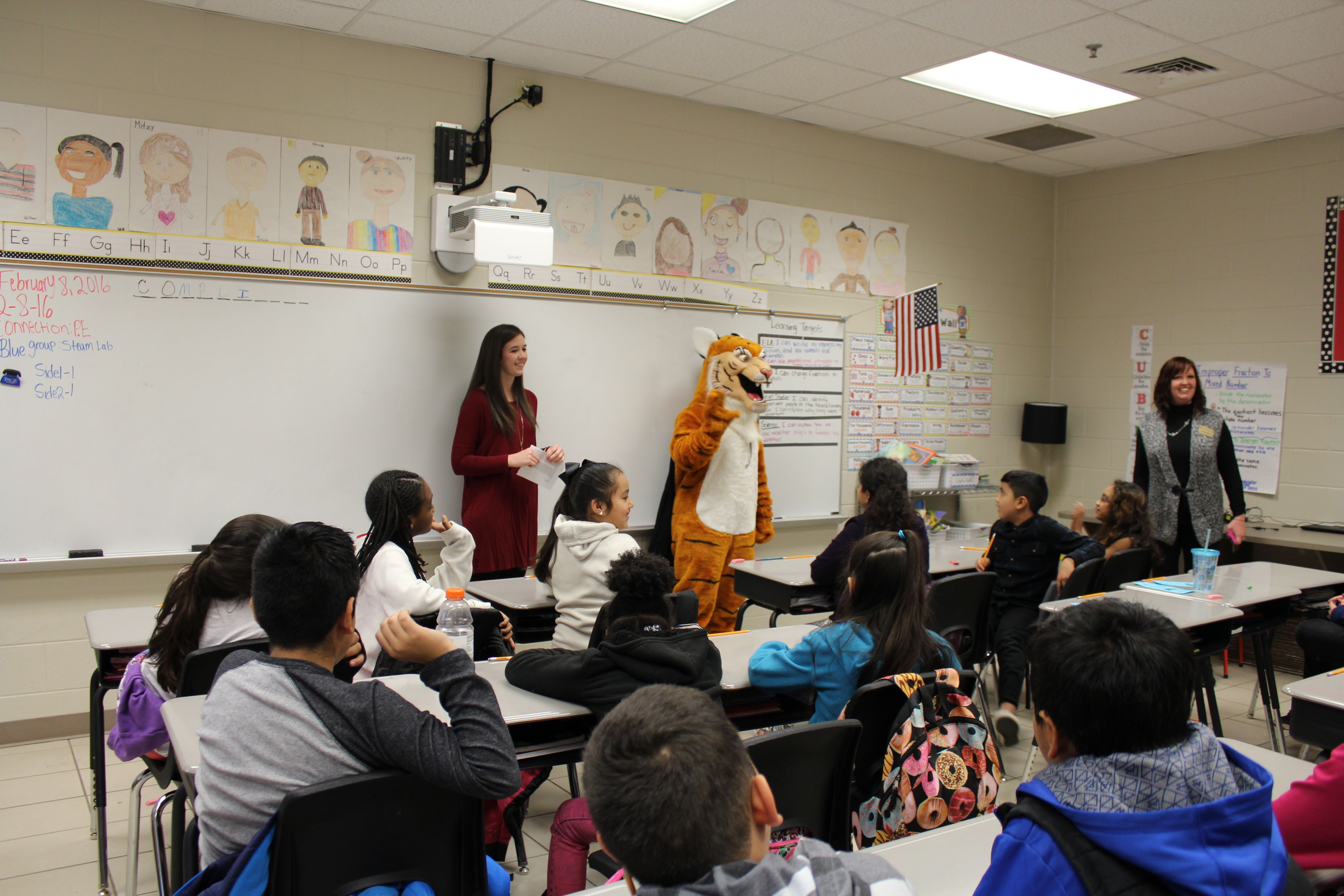 Middle grades education major Katelyn Brown, a junior from Hartwell, Georgia, instructs Fair Street School fourth graders under the supervision of Lucile the Tiger and Brenau professor Donna Cherveny.