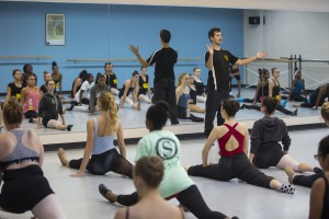 Adjunct faculty member John Streit hosts a class for high school students at the 2015 Day of Dance.
